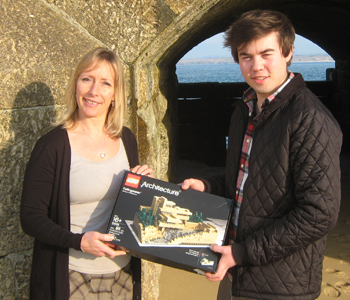 Oliver Laity accepts his award from Carol Rouncefield of Poynton Bradbury Wynter Cole.